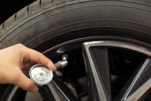 how do you put air in a car tire