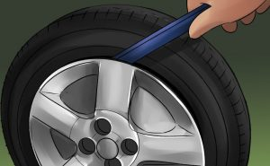 how to get a stuck tire off without a hammer