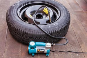 how to put air in a tire with an air compressor