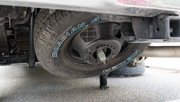 How to Put a Spare Tire Back Under a Truck