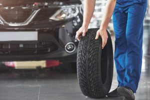 how to balance a tire by hand