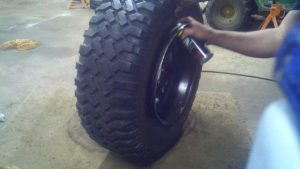 how to get a tire back on the bead