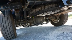 how to put spare tire back under truck