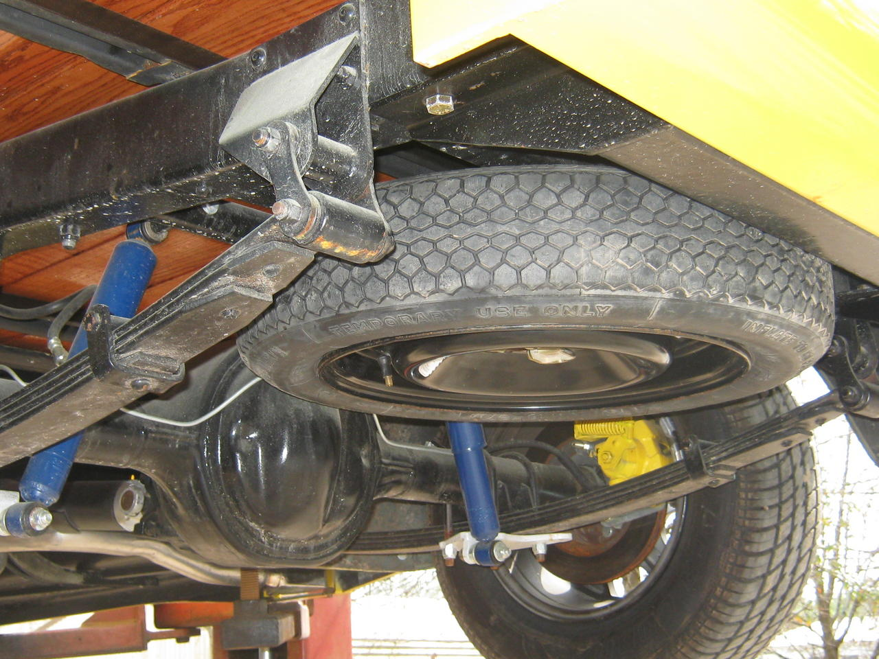 how to remove a spare tire